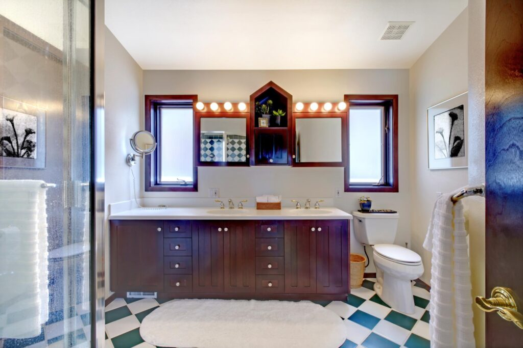 bathroom with white and green flooring tiles